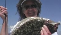 Join Theresa for Part 3 of  West Access Canal Redfish Trout and Flounder.