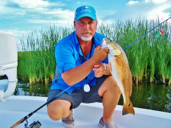 Plaquemines Fishing Charters - We specialize in fishing for redfish and speckled trout in the prolific waters of Plaquemines parish.Whether it's in the shallow marsh ponds or along our gulf beaches we will take you where the fish are.Come pass a good time with us.
