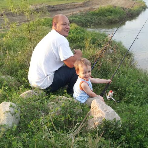 Luke catching sharks with his uncle Boudreaux in the spillway