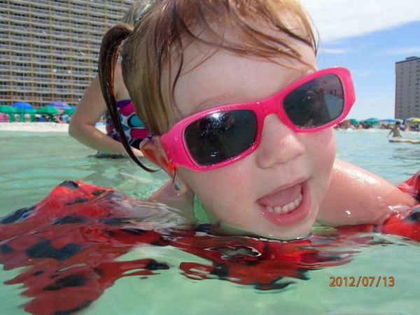 Kalleigh enjoying the clear blue water - Kandee Jacobs