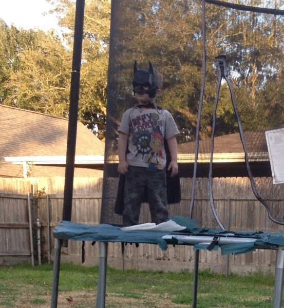 Batman on his off time, jumping on the trampoline\\