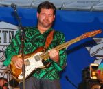 Mike Peters Beard: Tab Benoit bends the strings on his beat-up Telecaster guitar
